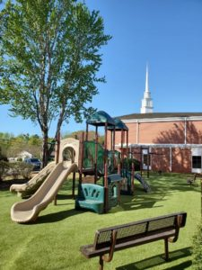 Awesome Church Playground with artificial turf and play equipment